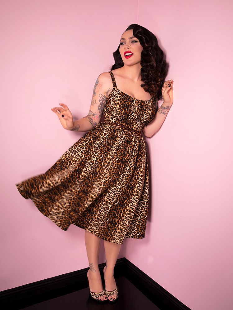 Laughing and giving her dress a twirl, Micheline Pitt is having fun in the Vintage Leopard Print Ingenue Dress from Vixen Clothing.
