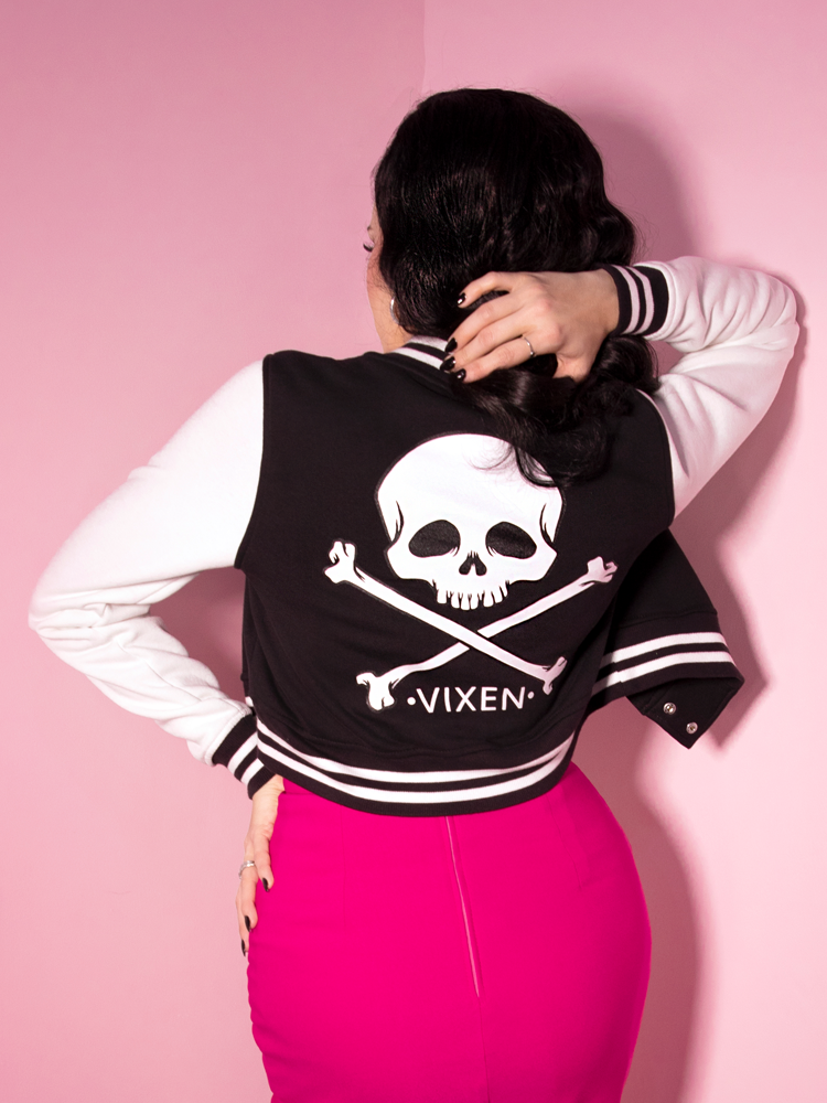 Micheline Pitt showing off the back of her hot pink retro skirt and Vixen Letterman Jacket.