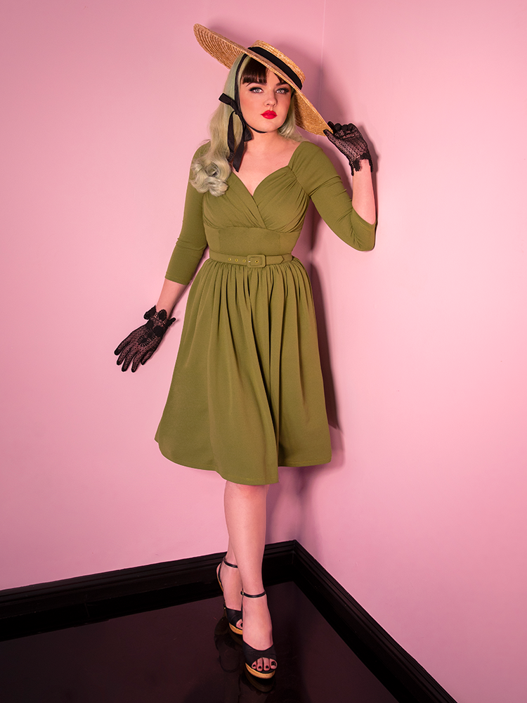 Moss green dress being worn by model.