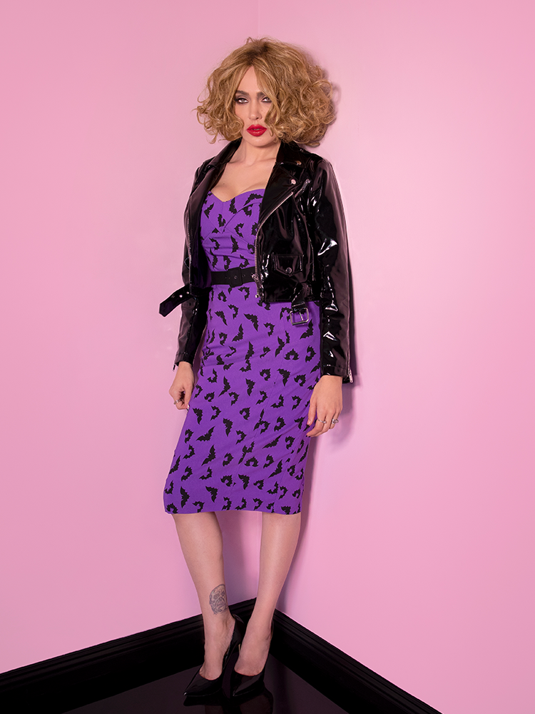 Micheline Pitt modeling her purple Miss Kitty Maneater Wiggle Dress in Bat Print from retro clothing maker and retailer Vixen Clothing.