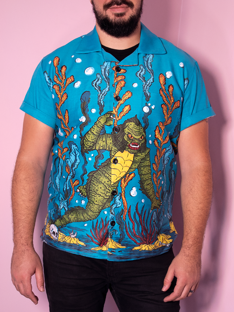 Straight on shot of male model wearing the retro shirt from Vixen Clothing featuring the swamp creature in the ocean print.