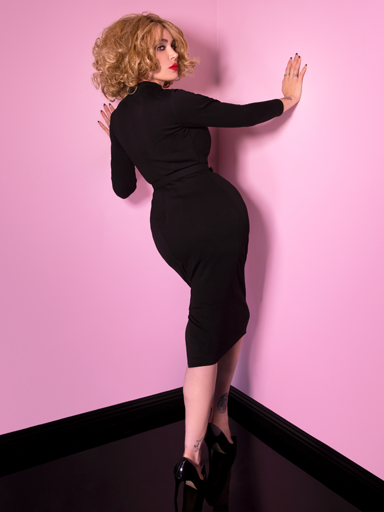 Micheline Pitt showing off the backside of the Bad Girl Wiggle Dress in Black.