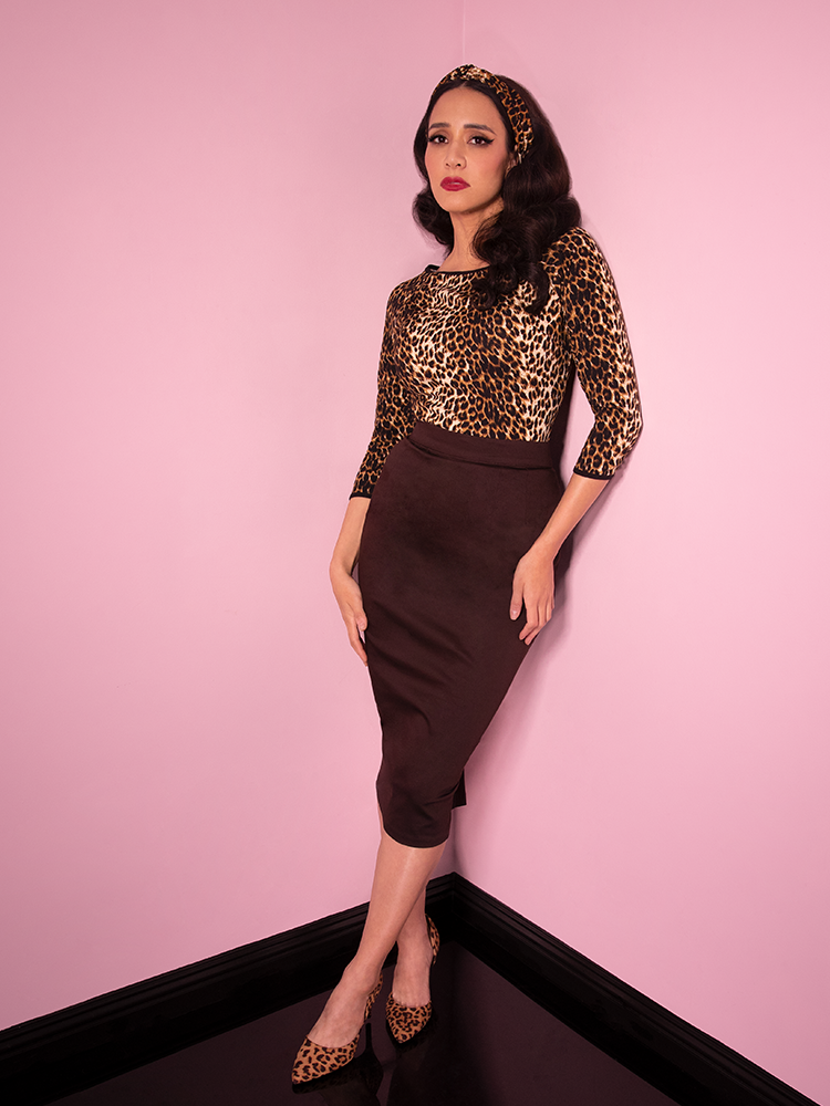 Model wearing the Vixen Pencil Skirt in Chocolate Brown from Vixen Clothing - the ultimate retro clothing and vintage inspired outfit retailer.