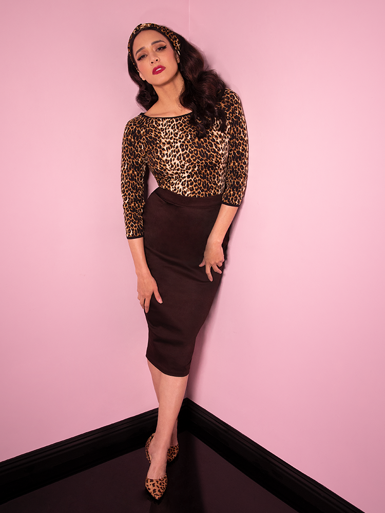 Model Milynn Moon wearing a leopard print top, leopard print headband and Vixen Pencil Skirt in Chocolate Brown.
