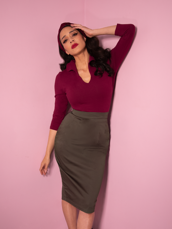 Milynn Moon in the vintage styled outfit from Vixen Clothing featuring the Vixen Pencil Skirt in Dark Sage along with maroon top.