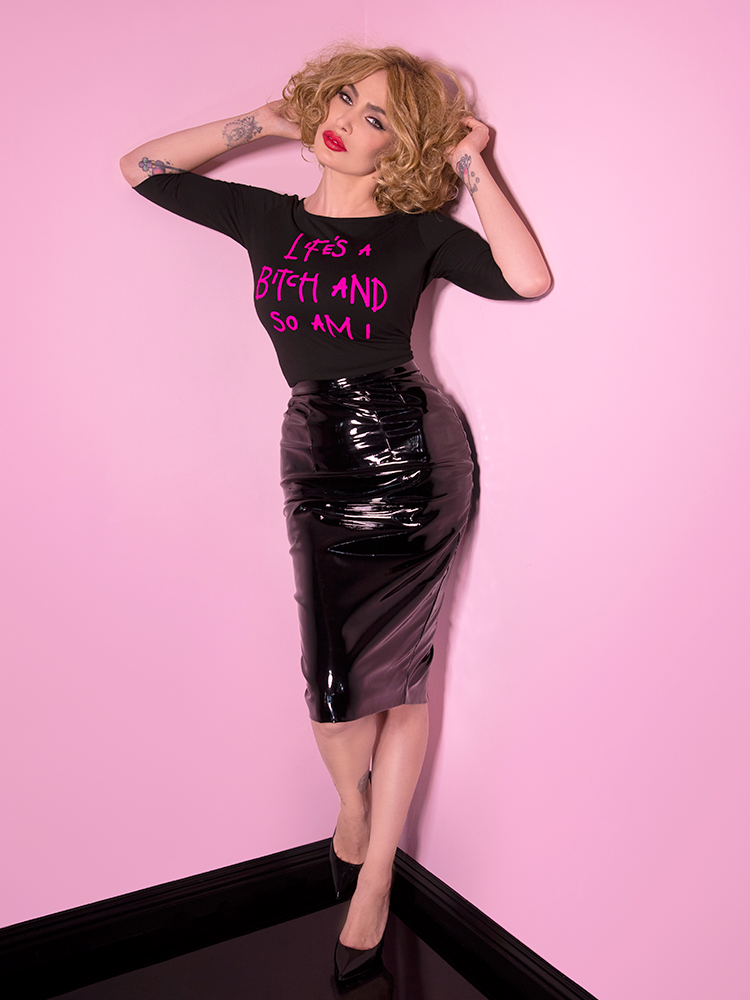 Decked out in all Vixen, Micheline Pitt stuns in the Miss Kitty Pencil Skirt in Black Vinyl and Vixen T-shirt.