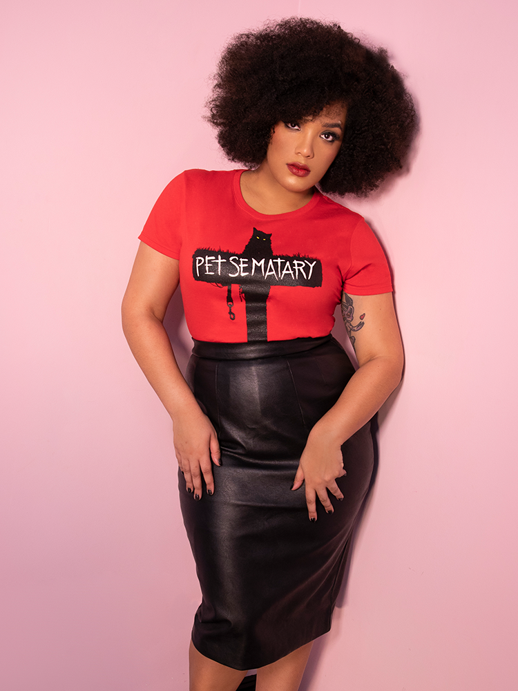 Model Ashleeta posing with a vegan leather skirt on with the Vixen Clothing Pet Sematary Church T-shirt in red.