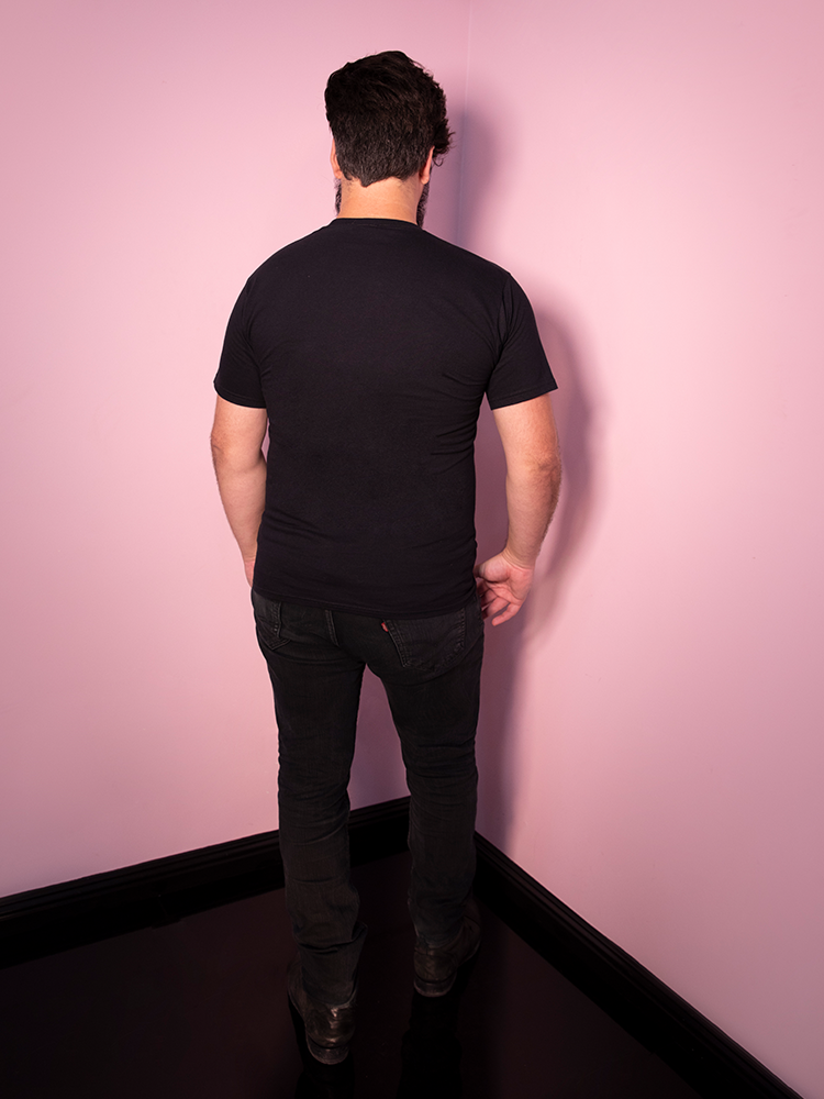 Back of Pet Sematary men's black shirt worn by male model.