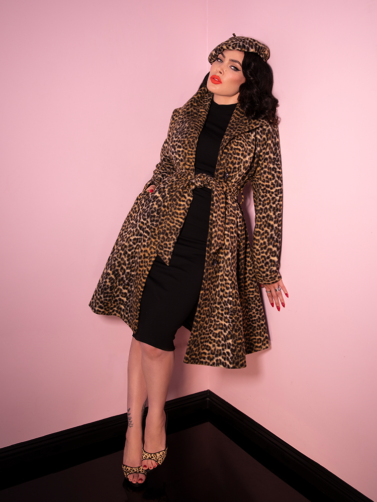 Full body image of Micheline Pitt modeling the Starlet Swing Coat in Leopard Print with similar print shoes and beret.