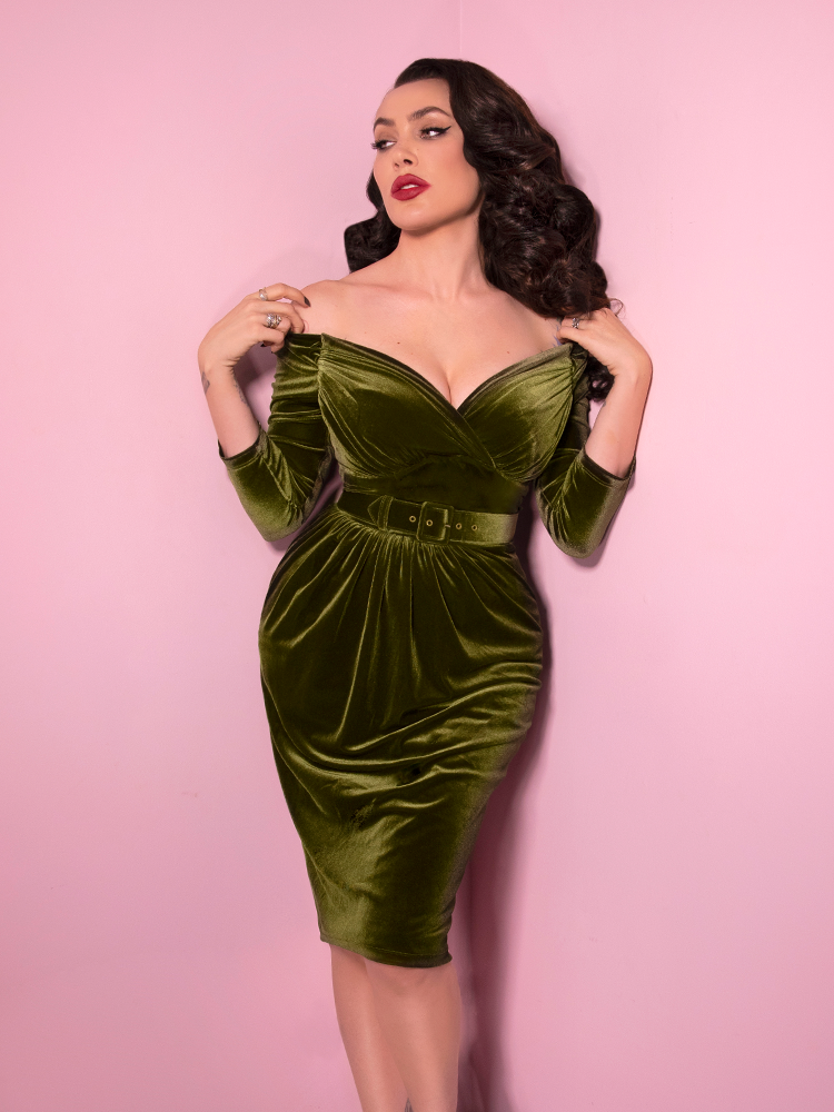 Looking like a modern day bombshell, Micheline Pitt shows off the Starlet Wiggle Dress in Olive Green from Vixen Clothing.