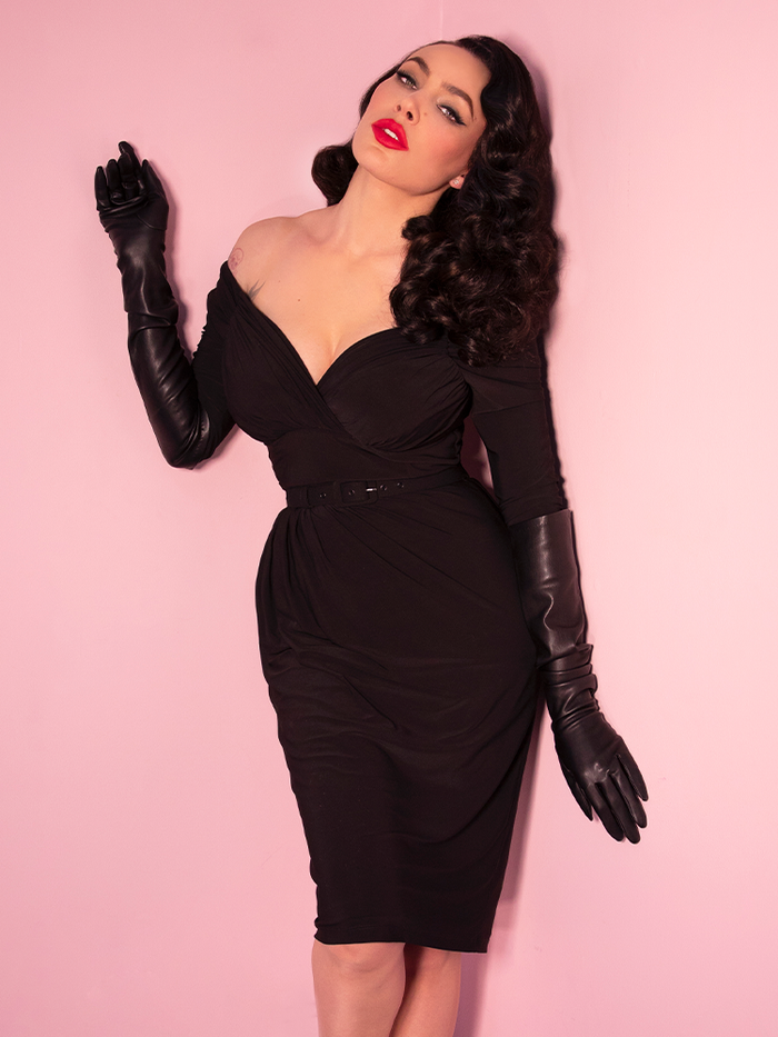 Micheline Pitt wearing a black retro style wiggle dress.