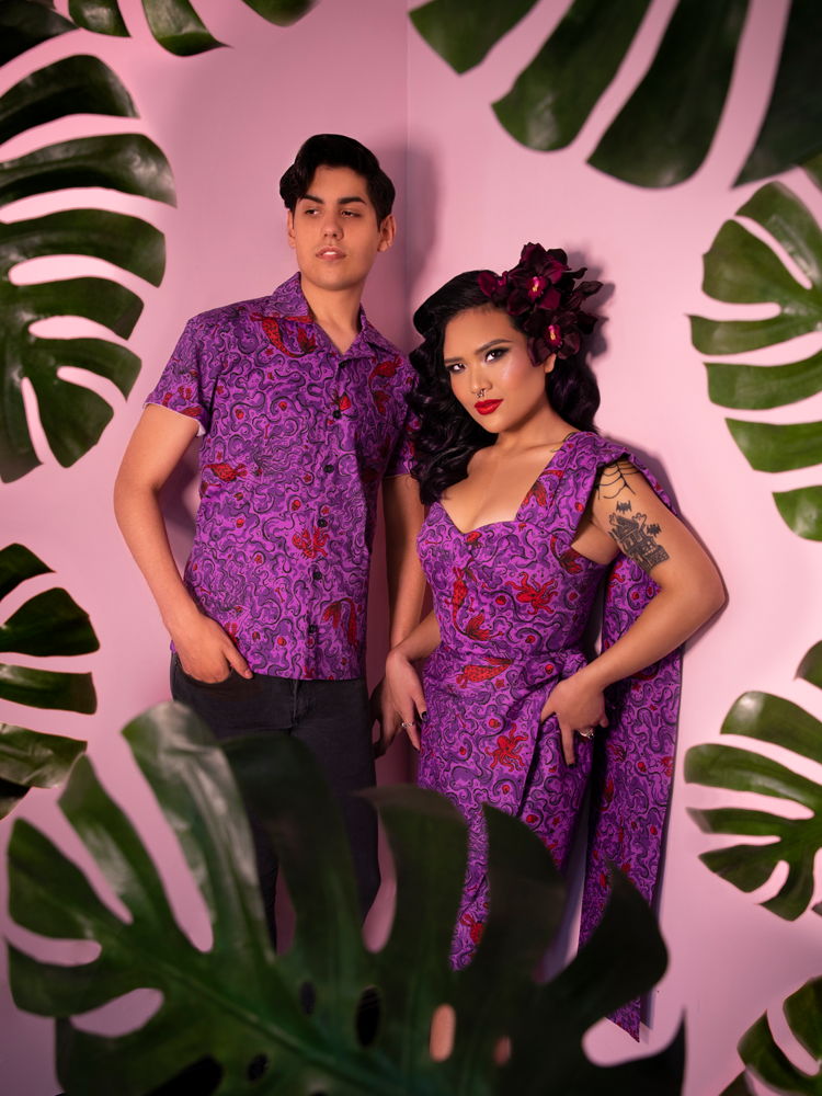 Two models, male and female, wearing matching novelty sea siren print outfits from Vixen Clothing.