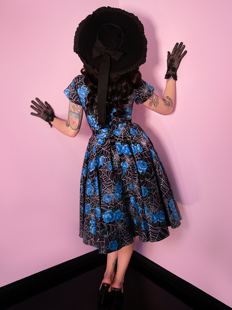 Vanity fair Dress from Vixen Clothing in blue rose and spiderweb pattern.
