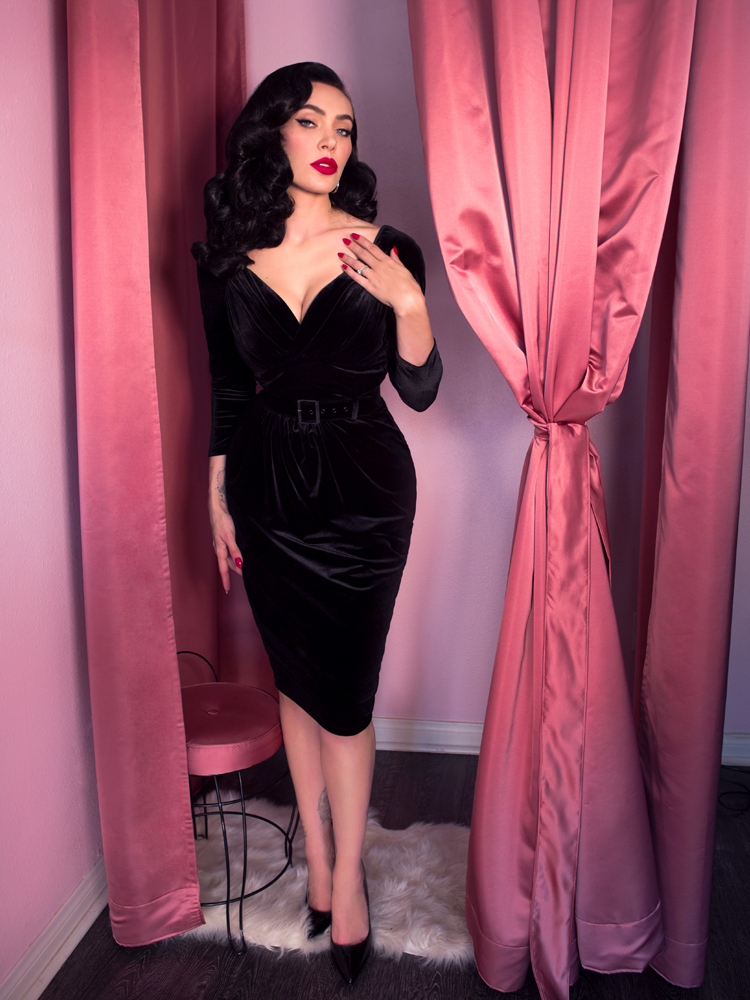 Micheline Pitt wearing black vintage inspired gown
