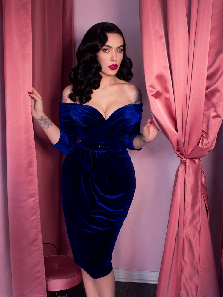 Micheline Pitt wearing blue fitted evening dress