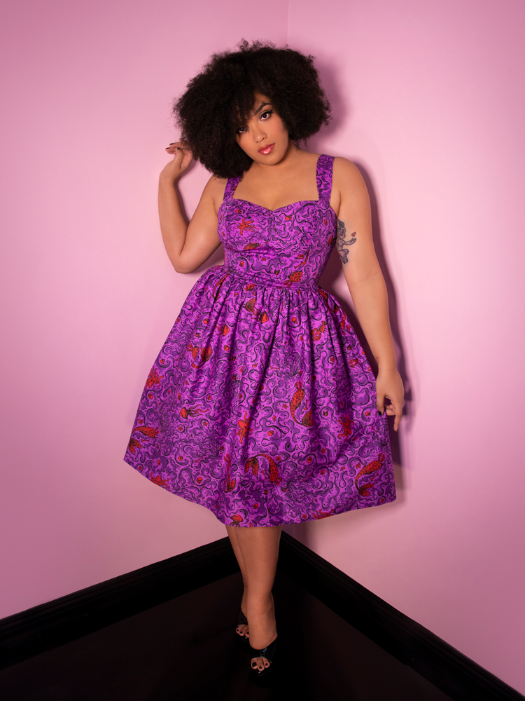 Full body image of model Ashleeta wearing the Tropical Terror Swing Dress in Sea Siren Print - a novelty style dress from vintage clothing maker and retailer Vixen Clothing.