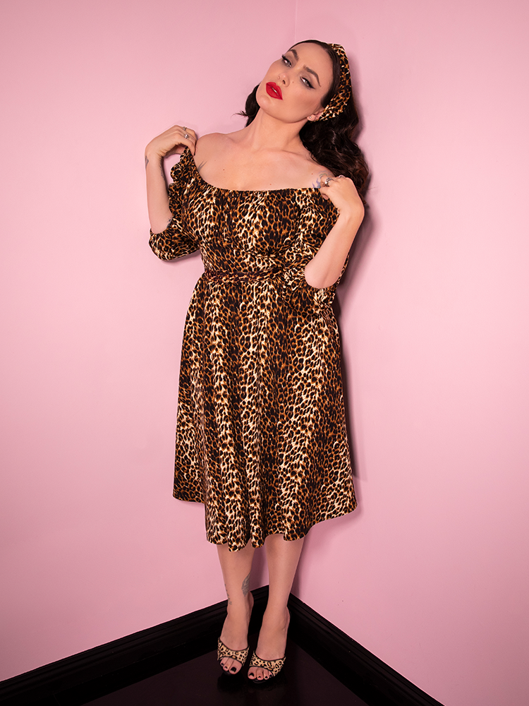 Playfully pulling the new leopard print dress from her shoulders, Micheline Pitt shows off a stunning all leopard print retro style outfit from Vixen Clothing.