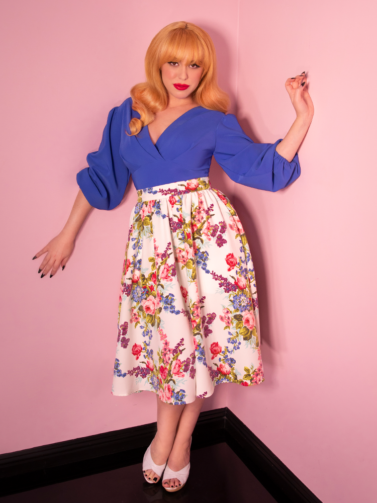 Full-body shot of vintage style cornflower blouse being worn by model.