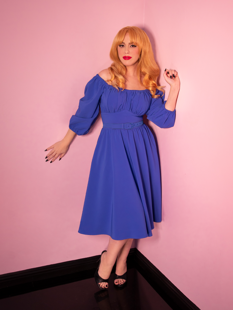Model wearing retro style dress in cornflower blue