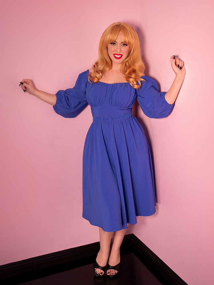 A full shot of Linda in motion modeling the Vacation dress in cornflower blue by Vixen Clothing.