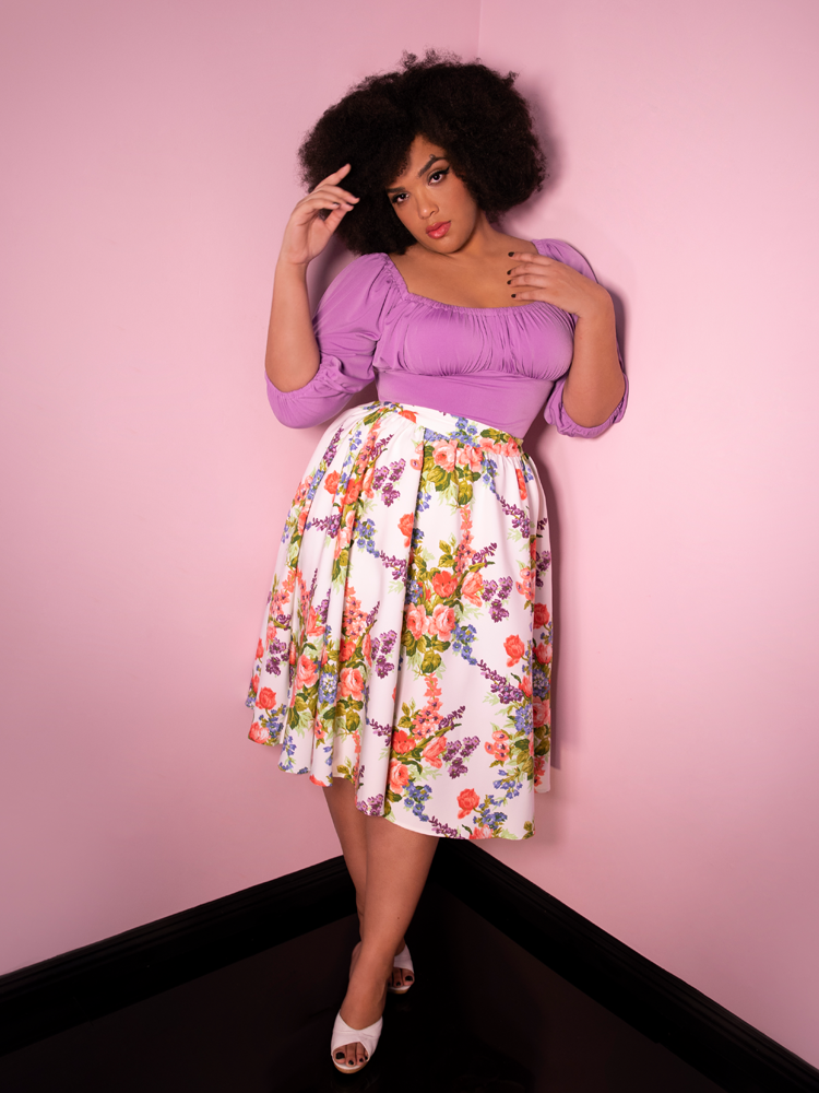 Model Ashleeta wearing a Vacation Swing Skirt in White Vintage Floral Print and long sleeve lavender top.