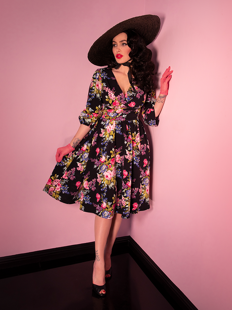 Micheline Pitt wearing a black floral retro style skirt.