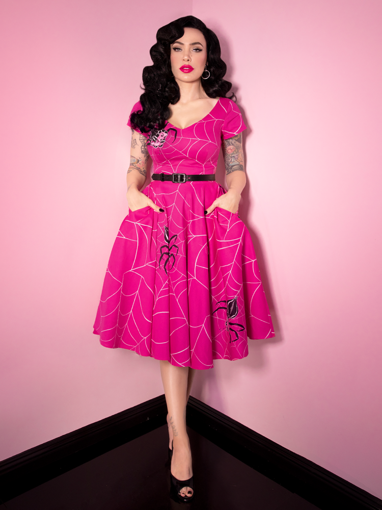 Micheline Pitt wearing her Vanity Fair Dress in Pinky Spider Print from retro clothing retailer and maker Vixen Clothing!