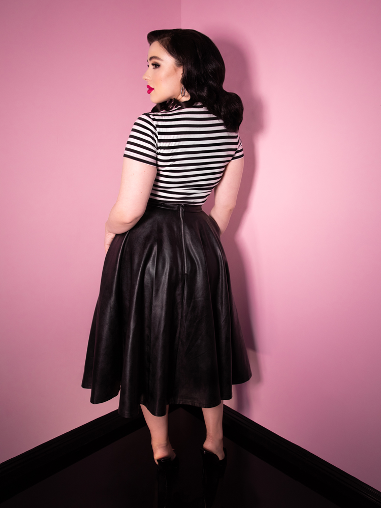 Back shot of model Rachel Sedory and the Bad Girl Circle Skirt in Vegan Leather from Vixen Clothing.