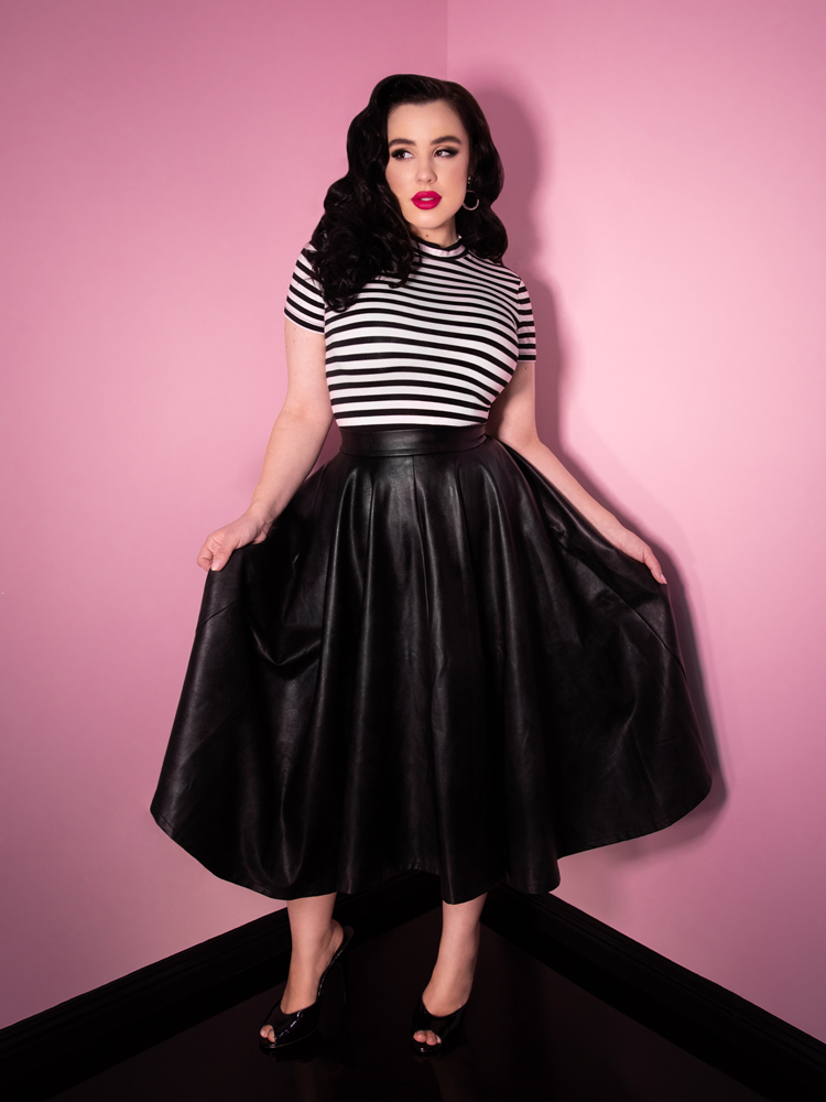 Pulling out the sides of the vegan leather skirt she's wearing, model Rachel Sedory looks like a vintage era model.