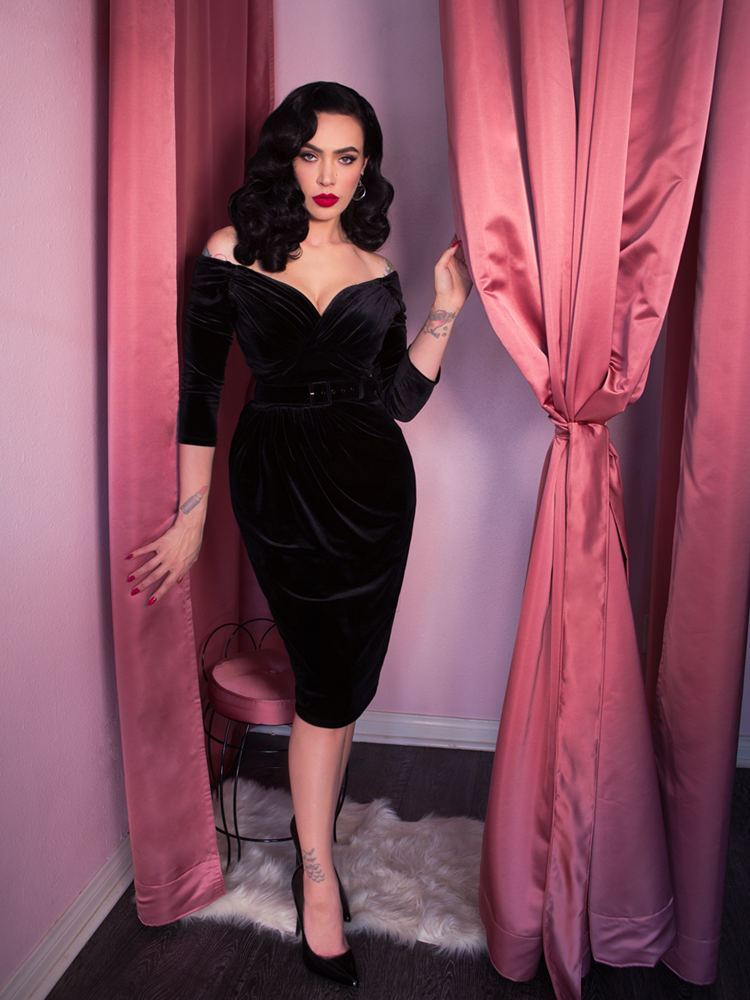 Micheline Pitt wearing black cocktail vintage style dress