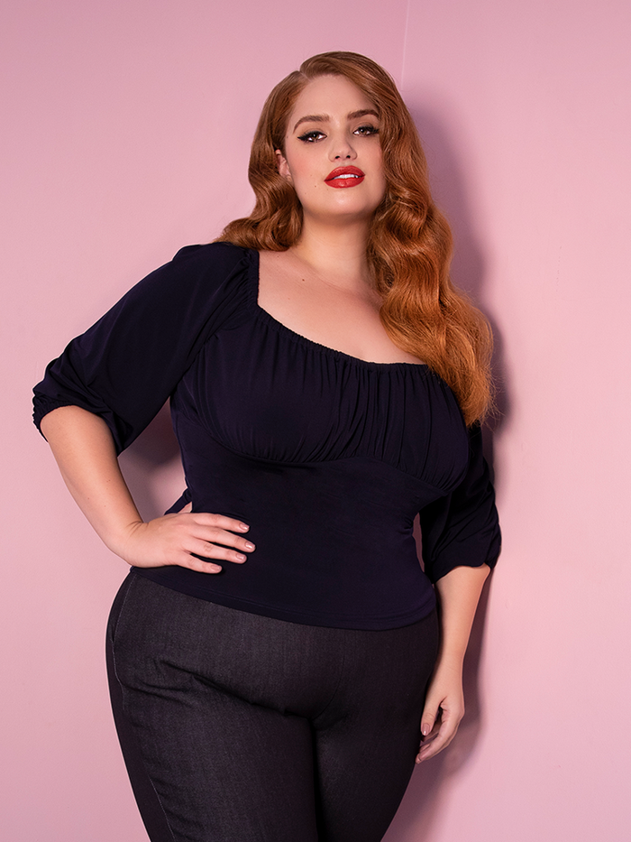 Model Bree wearing the vacation blouse in navy - a retro style top from Vixen Clothing.