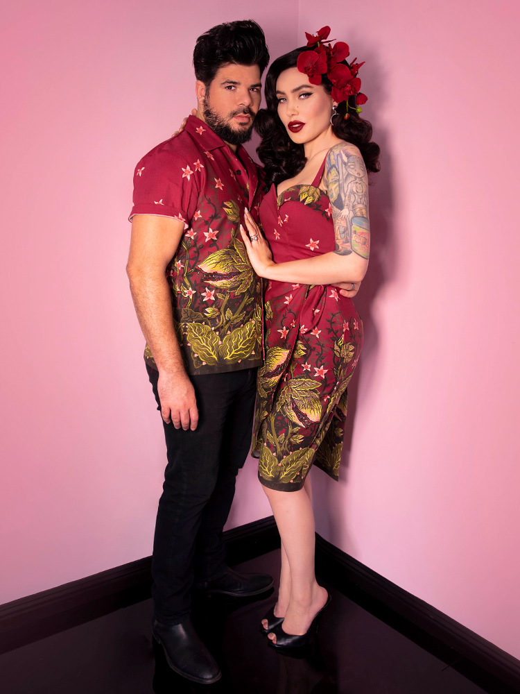 Male model and Micheline Pitt posing together  both wearing retro clothing items featuring the Maneating Monster Print.