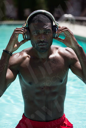 Man In The Pool With Headphones
