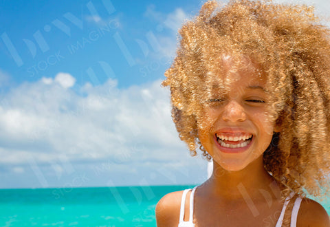 Little Girl Laughing On The Beach