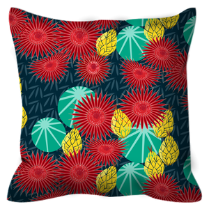 Picture of Snoring Dog Studio's outdoor pillow featuring a barrel cactus flower pattern
