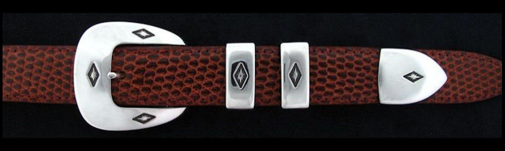"#0132 SIX STARS Buckle Set for 1"" belts priced from $180.00 for the single buckle to $445.00 for the 4 pc set. Extra tips are available for $95.00 - Santa Fe Buckle Company"