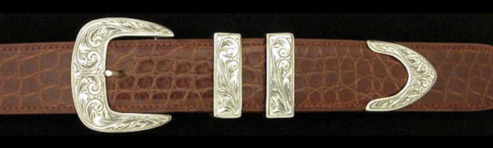 "#0884 ENGRAVED CLASSIC with FRAME TIP  4 pc Buckle Set for 1 1/4"" belts from $290.00 for the single buckle to $725.00 for the 4 pc set."