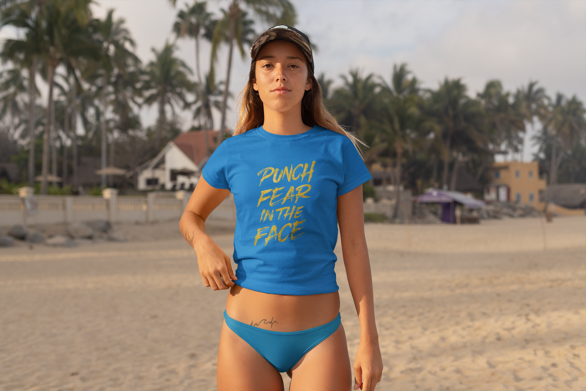 Surfer chick wearing Auspicious Victory t-shirt