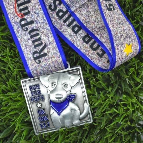 Run for Pups 2021 virtual race medal on grass