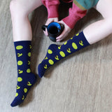 BARX SOX Navy Blue Dachshund Socks while holding Coffee