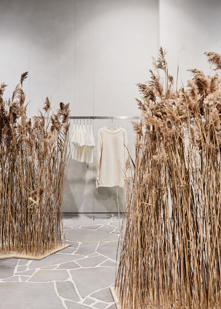 A field and un-dyed clothing in a store by A.BCH