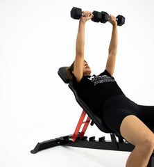 female doing dumbbell incline chest press on adjustable weight bench