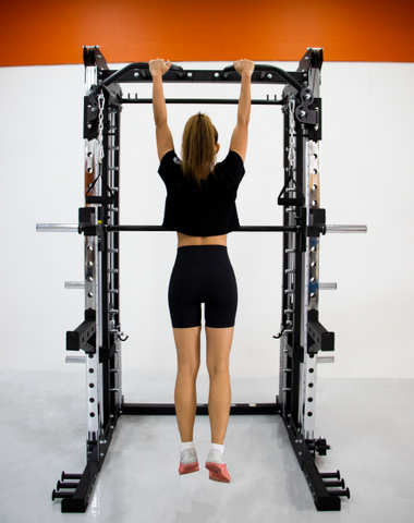 Female performing pull up using FT750 Smith Machine Rack