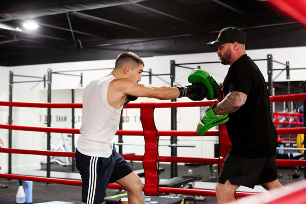 Sparring practice in boxing ring