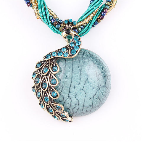 Crystal Peacock Pendant Necklace With Smooth Colored Stone