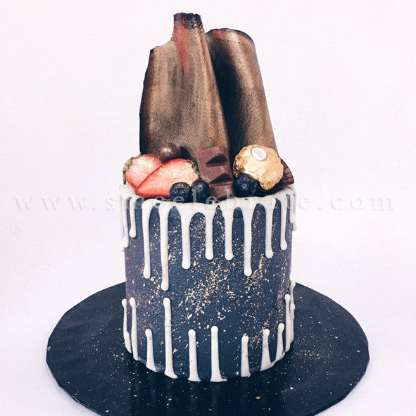 Chocolate Coated Cake with Chocolate Drips, Berries, Chocolate Sheets and Ferrero