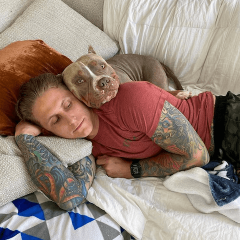 Bronson the rescue pup loves to cuddle with his dad.