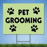 Coroplast Yard Sign with black text 'Pet Grooming' with pictures of paw prints on green background