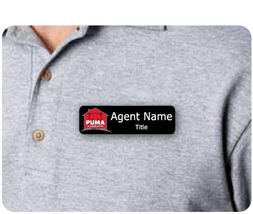 Name badge with PUMA Realty logo and agent name displayed on agent shirt