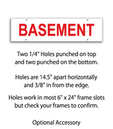 Sign rider with 4 holes saying 'BASEMENT' in red print